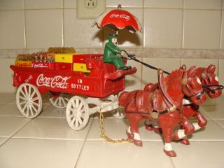 Vintage Coca Cola Cast Iron Horse Drawn Wagon with Miniature Crates of Coca Cola