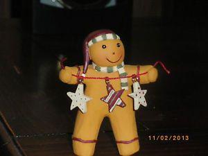 Blossom Bucket Resin Gingerbread Man Holding A String of 3 Stars Shelf Sitter