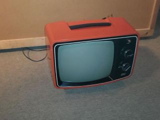 1976 Orange Solid State RCA Portable TV